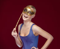 Young woman with masquerade masque Stock Photos