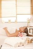 Young woman in massage parlour Royalty Free Stock Image