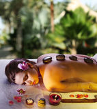 Young woman: massage procedure. Royalty Free Stock Images