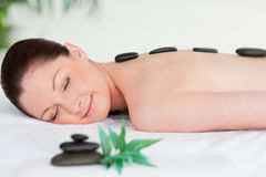 Young woman with massage stones Stock Photo