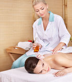 Young woman on massage table in beauty spa. Stock Image