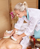 Young woman on massage table in beauty spa. Royalty Free Stock Photos