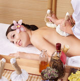Young woman on massage table in beauty spa. Royalty Free Stock Image