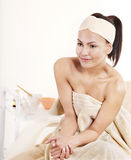 Young woman on massage table in beauty spa. Stock Images