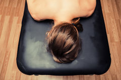 Young woman on massage table Royalty Free Stock Photos