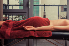 Young woman on massage table Stock Photos
