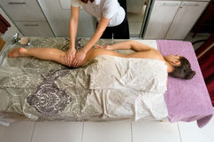 Young woman at massage therapy in spa centre Royalty Free Stock Image