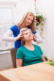 Young woman massaging female seniors scalp Stock Photography