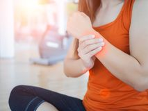 Young woman massaging her wrist after working out or injured royalty free stock photos