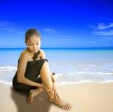Young woman massaging leg Stock Photography