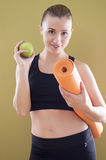 Young woman with mat and apple Royalty Free Stock Photo