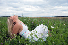 Young woman on a meadow Royalty Free Stock Photos