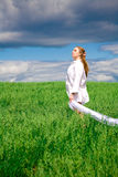 Young woman on a meadow Stock Photography