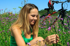 Young woman on a meadow Stock Photos