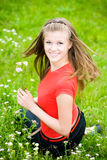 Young woman in a meadow Royalty Free Stock Images