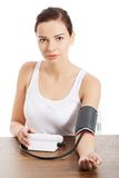Young woman measuring blood pressure Stock Image