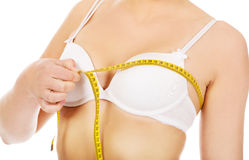 Young woman measuring her breast Royalty Free Stock Photo