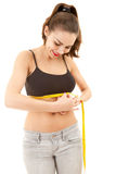 Young woman measuring her under breasts Royalty Free Stock Photos