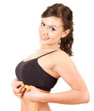 Young woman measuring her under breasts Royalty Free Stock Photography