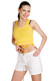 Young woman measuring her waist Royalty Free Stock Photo