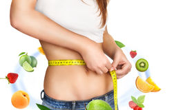 Young Woman measuring her waist. Royalty Free Stock Photography