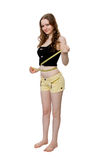 Young woman measuring her waist Stock Photos