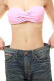 Young woman measuring her waist Stock Image