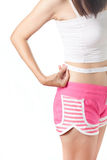 Young woman measuring her waistline with measuring tape Royalty Free Stock Images