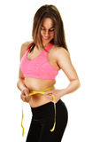 Young woman measuring herself. Weight loss Royalty Free Stock Image