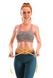 Young woman measuring herself. Weight loss Royalty Free Stock Images