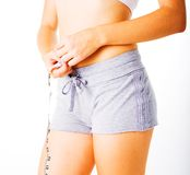 Young Woman Measuring Herself On White Stock Photo
