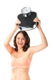Young woman with measuring scale Royalty Free Stock Photography