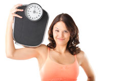Young woman with measuring scale Royalty Free Stock Photo