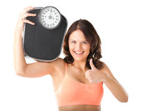 Young woman with measuring scale Stock Image