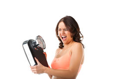 Young woman with measuring scale. Diet and weight, young woman with a scale, she is desperate and shouting Royalty Free Stock Photo