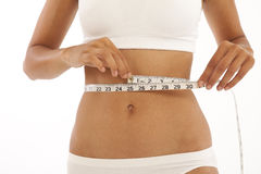 Young woman with measuring tape. Young slim woman with measuring tape Royalty Free Stock Photos