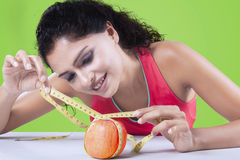 Young woman with measuring tape and apple Stock Image