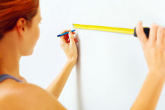 Young woman with measuring tape Stock Images