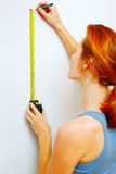 Young woman with measuring tape Stock Image