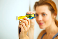 Young woman with measuring tape Royalty Free Stock Photo