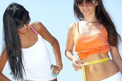 Young woman measuring waist Stock Photos