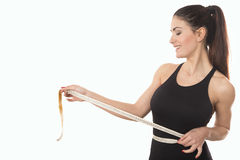 Free Young Woman Measuring Waist With Tape Measure Stock Photo - 95913980