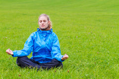 Young woman mediating Royalty Free Stock Images
