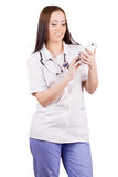 Young woman medical doctor with mobile phone. Royalty Free Stock Photography