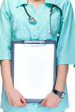 Young woman medical doctor with notebook Royalty Free Stock Image