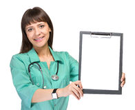 Young woman medical doctor with notebook Stock Photography