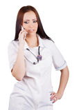 Young woman medical doctor talking on mobile phone. Stock Photo