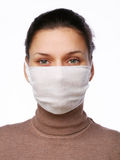 Young woman in medical mask. On a white background Stock Photo