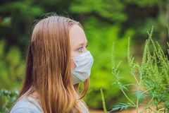 Young woman in a medical mask because of an allergy to ragweed.  Stock Images