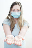 Young woman in medical mask. Focus on hands. On white background Stock Images